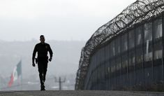 FILE - In this June 22, 2016, file photo, Border Patrol agent Eduardo Olmos walks near the secondary fence separating Tijuana, Mexico, background, and San Diego in San Diego. U.S. immigration authorities caught barely half the people who illegally entered the country from Mexico last year, according to an internal Department of Homeland Security report that offers one of the most detailed assessments of U.S. border security ever compiled. The report found far fewer people are attempting to…