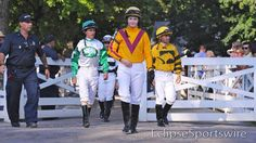 Rosie leads the jockeys to the track at Saratoga