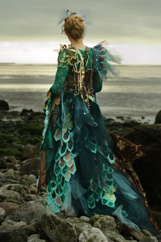 'Shipwrecked' dress by Duxbury Designs. Blue and green net with turquoise leatherette scales, pearls, beads and buttons. Inspired by seaside debris and fish. www.duxburydesigns.co.uk