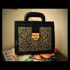 Beautiful Snake Print Vintage Bag This gorgeous Snake Print Vintage Bag is awesome. It has a unique clasp in the front and is in perfect condition. Bags by Marlo Bags