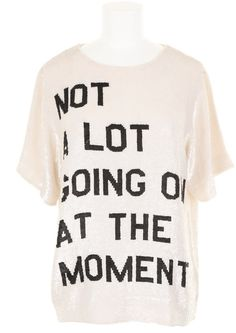 """Not A Lot Going On At The Moment  After watching Taylor Swift's new 22 video, I got online and started looking where to buy Taylor's shirt. Apparently, her white """"Not A Lot Going On At The Moment"""" top was very popular, because it sold out immediately, even though it cost $895!"""