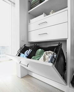 This drawer pulls out to a sectioned hamper -- keeping laundry and dry-cleaning piles organized and ready to be cleaned.