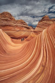 The Wave, in Utah has become a popular attraction in the Coyote Buttes area of the Paria Canyon-Vermillion Cliffs Wilderness on the Utah/Arizona border.  The Wave is a multi-colored chute that has been cut into a sandstone mountain. via bloggerpixz