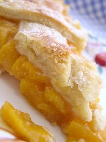 Peach Pie - This peach pie recipe uses fresh peaches for a taste of summer in every bite. It's easy to make and smells fabulous as it bakes.