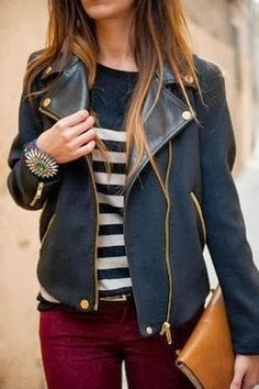 Black leather jacket, white lined shirt, red pant and brown hand bag