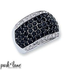SUPREME RING The curved crown of this ring is silver and encrusted with black pave cubic zirconias and outlined with clear CZ's. Sizes 6-10