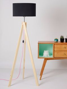 Tripod floor lamps inspirations for your living room decor.