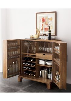 Shop Marin Natural Bar Cabinet. Centuries of Chinese craftmanship meet mid-century modern in a warm, minimal classic.