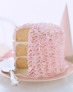 Ruffle Tower Cake: Inspired by ruffled tap pants, this cake is covered with frilly rows of white and pink frosting piped from a single bag. Three tender lemon layers make this birthday cake tall enough to show off the ribbon-candy effect of the frosting and ensure there is plenty for everyone.