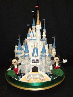 Sleeping Beauty's Castle with 2 Mickey Mouse's cake. If only Minnie were on it then it would be perfect!