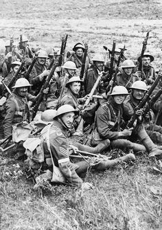 Battle of the Somme. Troops of the 4th Battalion, Worcestershire Regiment , 29th Division, resting, on their way to the trenches. Note wire cutters attached to rifles, Acheux-en-Amiénois, 27 June 1916. ©IWM ( Q 718)