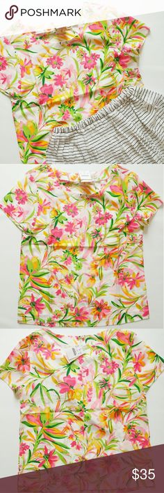 J Crew Floral Top This is a very summery and beautiful floral top by J Crew. The size is XS. Material is 100% Polyester. The back has a button on the top with a small slit. J. Crew Factory Tops Blouses