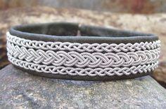 Sami bracelet, perhaps in light blue.