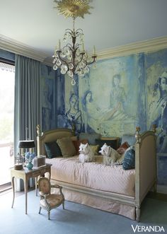 Terriers Kippy of the Cavendish and Piper Dundee sit on an antique daybed in designer Hutton Wilkinson's opulent Beverly Hills home; above them is a Tony Duquette chandelier. - Veranda.com