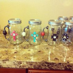 Mason jar mugs - these would be fun for a future craft or even to do for a MNO. Could even get actual mason jar mugs with the handles already part of the glass and just adorn with a cross or other pretty accents. Mason Jar Mugs, Pot Mason, Mason Jar Gifts, Mason Jar Diy, Jar Crafts, Cute Crafts, Bottle Crafts, Crafts To Make, Craft Gifts