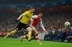 Lukasz Piszczek of Borussia Dortmund and Alexis Sanchez of Arsenal compete for the ball during the UEFA Champions League Group D match between Arsenal and Borussia Dortmund at the Emirates Stadium on November 26, 2014 in London, United Kingdom.