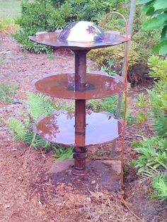 My hubby made me the neatest bird bath out of old plow discs--it is constantly dripping very slowly.  I absolutely adore it!!!