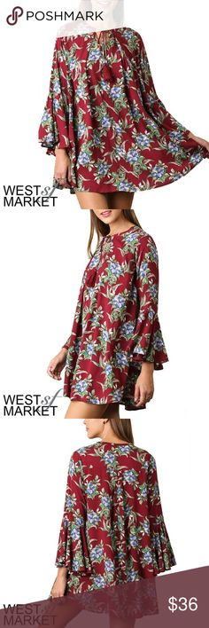 -NEW ARRIVAL- The Adeline Tunic Beautiful long sleeve tunic in a rich red color. Blue and green flowers bring the fun to this perfect wardrobe staple, which ties together with a tassel around the neck. West Market SF Tops Tunics