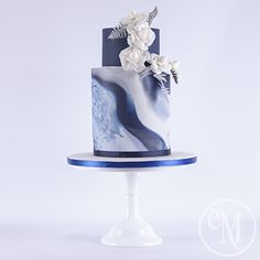 Blue marble wedding cake with Chanel inspired camellias