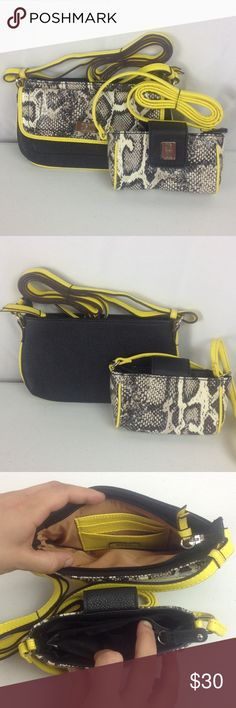9 & CO. Shoulder Purses Snake Print Yellow Border These purses are in like new condition! This beautiful set features a snake skin print with black and yellow accents, long (adjustable on larger purse only) shoulder straps, and multiple storage compartments. The larger purse measures 9in x 5 1/4in x 1/2in and the smaller measures 6in x 3in x 1 3/4in. All reasonable offers will be accepted. 9 & Co. Bags Shoulder Bags