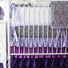 Awesome Sparkling Cheetah Print Bedding And Gift Very Interesting For Family: Dark Purple Cheetah Print Bedding With White Wooden Cabinet And Unique Iron Bassinet Also White Pillow For Baby Bedroom Idea