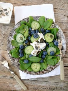 spinach, cucumber, blueberry, goat cheese, and pumpkin seed salad