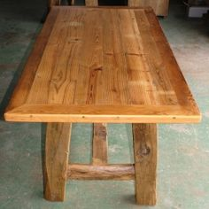 Antique long leaf pine table with rustic beam legs.  a great dining room harvest table that can be formally dressed up or everyday casual.