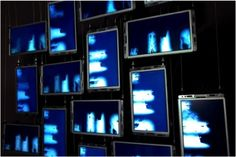 """Hong Kong City University grand opening exhibition in 2012. City University, Run Run Shaw Creative media centre. Made using sixteen x 10"""" VideoFlyer Open-Frame, with video synchronized across all the LCD displays. Media-player is ViewStream 300."""