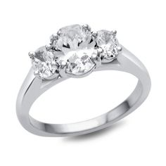 ($2530) SES Creations three stone oval diamond engagement ring, available at Diamonds Direct. A stunning three stone diamond engagement ring with a beautiful classic shank is a breathtaking choice for the timeless women. Total carat weight is 0.50. #oval #diamond #threestone #whitegold #engagementring