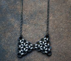 Kawaii Black and Silver Bow Tie Pendant on by GeekyGaeaDesigns