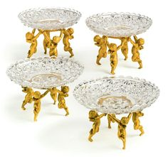 """Cristalleries de Baccarat """"Garniture de Table"""", two pairs of gilt bronze and cut crystal sweatmeat dishes Paris, late 19th/early 20th century."""