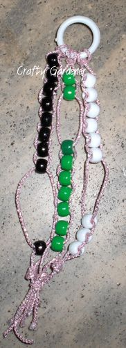 Crafty Gardener: Make a simple counting bracelet with cord and beads. With this style, beads are moved back and forth (rather than other styles where a beaded ring is moved between beads).