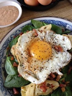 Sunny Side Up Spinach Salad with Artichoke Hearts, Pancetta Crisps