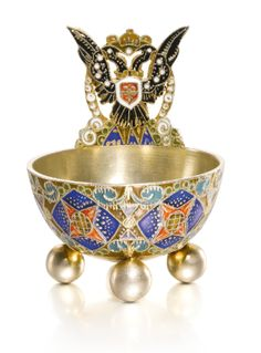 A Fabergé silver-gilt and cloisonné enamel salt, workmaster Feodor Rückert, 1908-1917; the rim is surmounted by the Russian Imperial eagle. (Sotheby's)