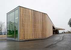 shipping container house with pallet cladding