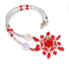 One of a kind Red and White Beadwoven Snowflake Necklace by Giftbearer on Etsy, $56.00. Get it in time for Christmas via Priority mail now; https://www.etsy.com/listing/173112758/red-and-white-beadwoven-snowflake?ref=shop_home_active Gift-wrapping available upon request through December.