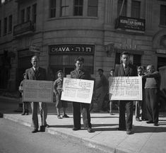 """""""'Save our children and our parents!' say these Jewish placards carried by men in the streets of Jerusalem, Israel on Jan. 16, 1939. 'Open the gates of Palestine to the times of Nazi prevention hatred at the Christmas period we are crying from the holy city of Jew Salem to all Christian nations to help us against Germany.""""  (AP Photo) Date: 16/01/1939"""