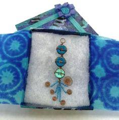 ARTISUN: 7th Grade Collage Boxes- like the pendants