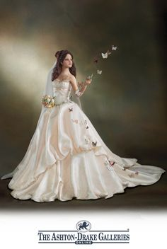 Handcrafted poseable bride doll features fabric butterflies that soar on a nearly invisible, poseable wire. Silken fabric gown, rhinestones, more.