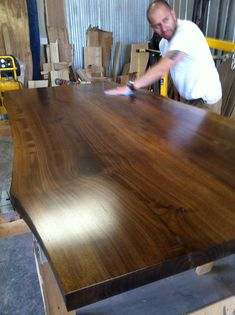 TREEGREENTEAM.COM 705.607.0787 or 705.606.1568 100% SALVAGED TREES BROUGHT BACK TO LIFE!  You are viewing a black walnut live edge table.