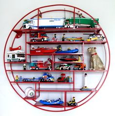 Radial Wall Shelf by The Land of Nod - great for a boys room to display all the trucks, cars and trains!