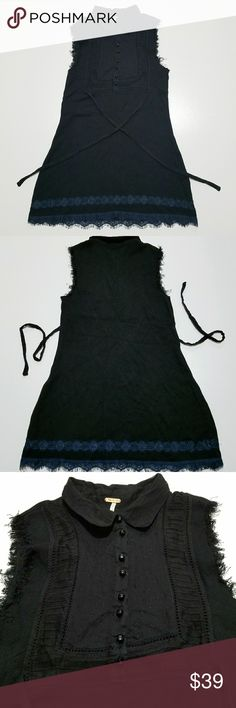 Free people sleveless tunic Black tunic top with lace blue hem. Warm cotton fabric. Perfect with leggings and boots. Ties on the back. Frye sleveless, buttons on center. In like new condition. Free People Tops Blouses