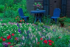 Blue garden table and chairs in a garden