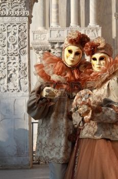Masked  couple at Venice Carnival . Marble columns in background  photo