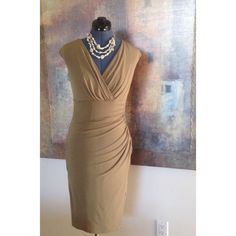Sangria green jersey dress. Sleeveless beautiful jersey dress. Wrap bustling with cinched waist compliments the waistline. Poly/ spandex blend. Would fit size 4-6 given quality of fabric. Sangria Dresses
