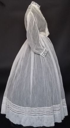 Nice sheer gown, and lovely tucks! No attribution. Of course, all the correct undergarments would be worn under this.