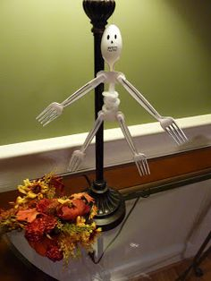 I saw this skeleton on a Woman's Day website and I fell in love with it. We used: 4 plastic forks, 1 plastic spoon, 1 white chenille stem,a ...