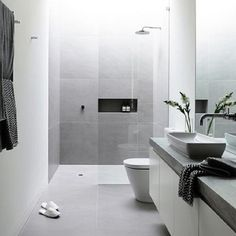 Concrete look tiles and frameless showers ☝ #stylishinteriors