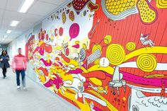 The murals provide visual respite for the staff who spend much of their time on the phone.