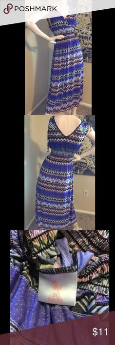 """Sleeveless Multi-colored V-Neck Dress Pre-owned. Mid section is stretchy. Size Medium / Large.   97% Polyester  3% Spandex  Machine was cold  Laying flat: Shoulder to bottom of dress: about 49"""" Dresses"""